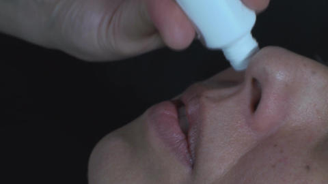 Mature Woman Dripping Medicine Into Her Nose Still stock footage