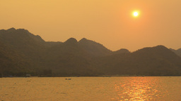Sun Setting Over Mountains And A River In Thailand stock footage