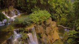 Rockface and Waterfalls in a Jungle in Kanchanabur Footage