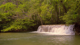 Small Cascading Waterfall in a Jungle in Thailand Footage