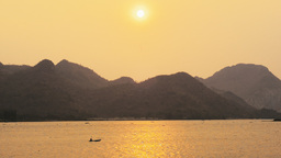 Sun Setting Over Mountains And Water In Thailand stock footage