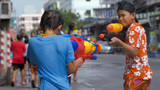 Young Boys Shooting Water Pistols At Each Other Du stock footage