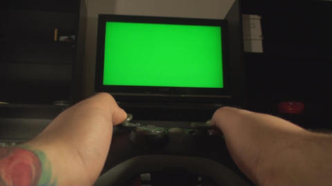Male Hands Playing With A Console Controller And A Live Action