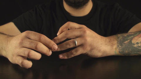 Young Male Playing With A Ring On His Finger Front Footage