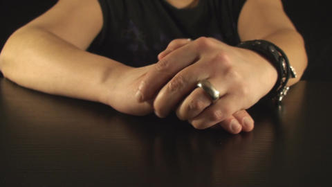 Mature Female Putting A Ring On Her Finger Front-S Live Action