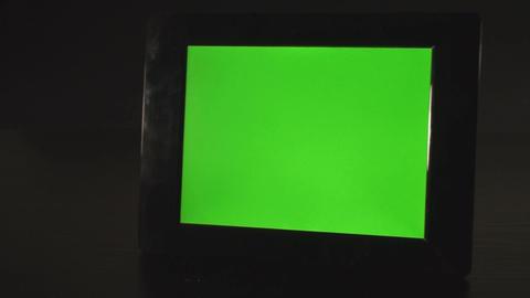 Green Screen Photo Frame On A Desk Pan-Shot Footage