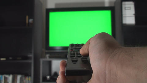 Male Hand With TV Remote Switching Channels On A G Footage
