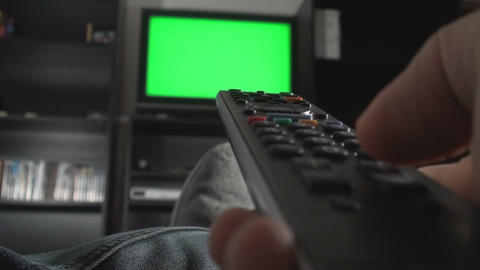 Hand Switching Channels On A Green Screen TV Focus stock footage