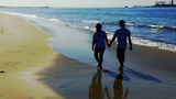 Romantic Hispanic Couple Walking On Beach stock footage