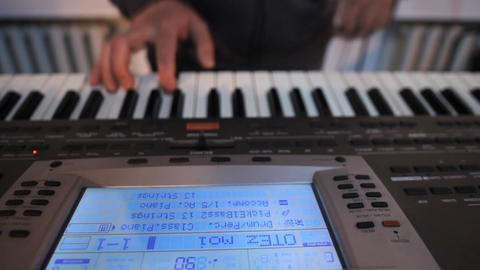 Playing Keyboards B stock footage