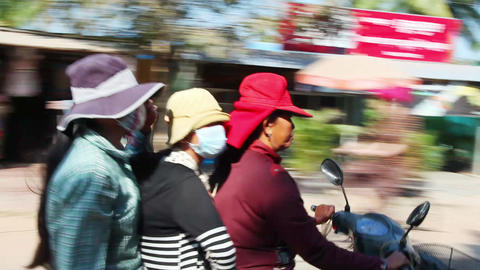 Three women are moving on a motorbike Footage