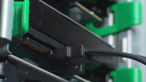 Man Connecting SATA And Power Cable Into A Hard Di stock footage