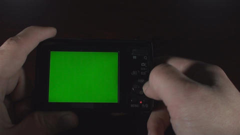 Man Taking Pictures With A Digital Camera Green Sc stock footage