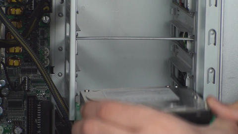 Man Inserting Hard Disk Drive Into A Workstation H stock footage