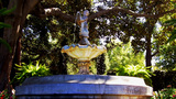 Victorian Era Fountain In Garden Setting Wide stock footage