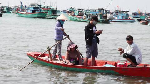 People swim in the boat. Vietnam Footage