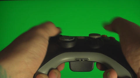 Hands Playing On A Video Console Controller On A G Footage