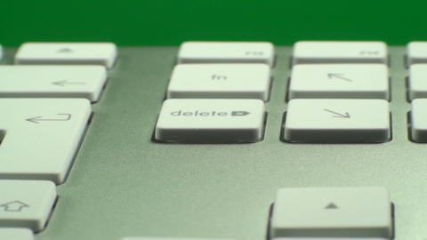 Hand Pressing The Delete Key On A Keyboard On A Gr Live Action