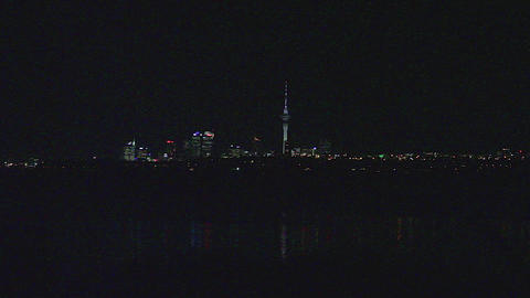 view of auckland skyline at night from Te Atatu Pe Live Action
