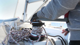 Sailor's hand on a winch of sailing boat Footage