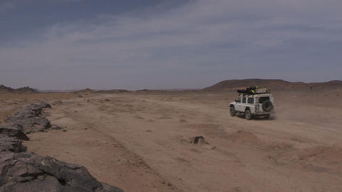 FT 0066 SUV On Rough Desert Road 24 P Aud PJ 95 stock footage