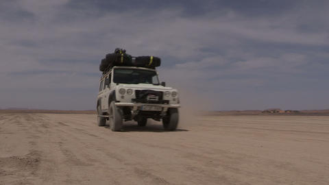 FT 0068 SUV Approaches On Desert Flats 24 P Aud PJ stock footage