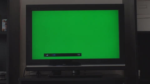 Turning Up The Volume On A HDTV With A Green Scree Footage
