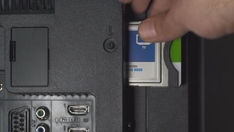 Hand Unplugging Network Card From A HDTV Point Of  Footage