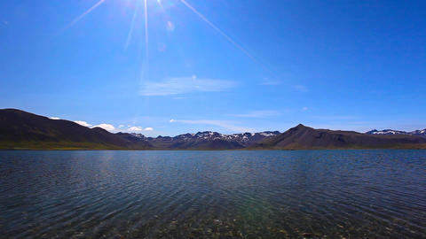 Snowy Mountains With Blue Sky On A Lake In Iceland stock footage