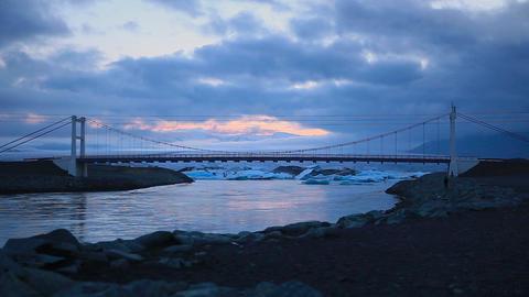 Suspension bridge across a river in Austurland Footage