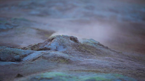 Boiling mud with yellow sulphur crystals Footage