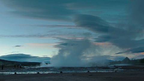 Erupting geyser Strokkur shooting up a column of s Footage