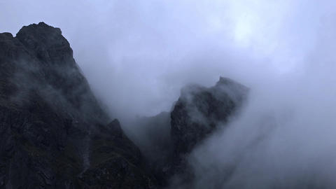 Rugged Mountain Peaks In Mist In Iceland stock footage