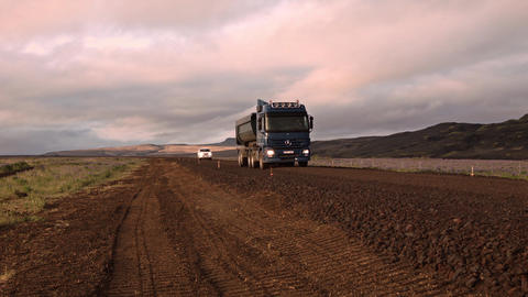 Transport truck and car on the road in Iceland Footage