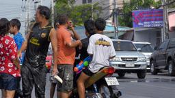 Men on a Motorbike Getting Splashed in a Songkran Footage