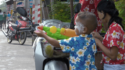 Boy Shooting Water Pistol During The Songkran Fest stock footage