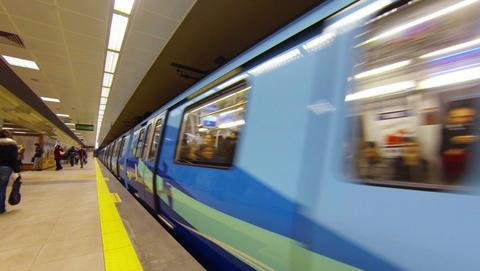 Train Departing The Platform In A Metro Station In stock footage