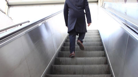 Man walking up stairs from subway station Footage