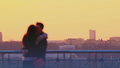 Young couple kissing at sunset Footage