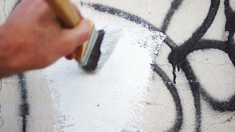 Painting Over Graffiti Close Up Live Action