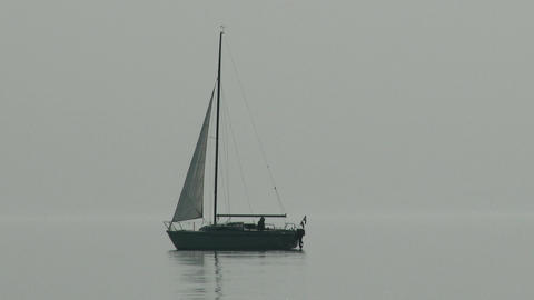 4 K Small Sailing Boat in Lake Misty Weather 1 Footage