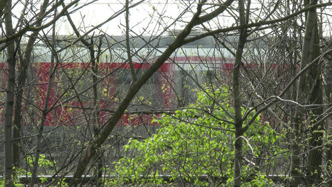 4K Train Behind Trees Industrial Area 4 stock footage