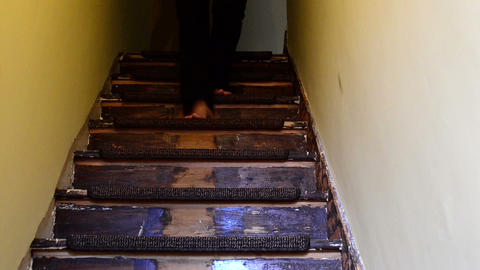 woman down the stairs barefoot view from below Footage