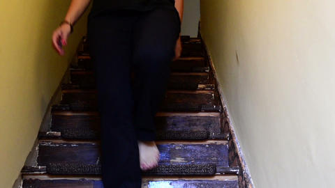 woman down the stairs barefoot view from below, Live Action