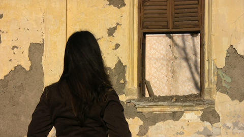 Girl Looking at an Old Abandoned House Footage