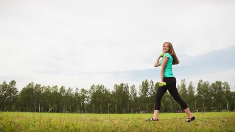 Woman With Dumbbells in a Meadow Footage