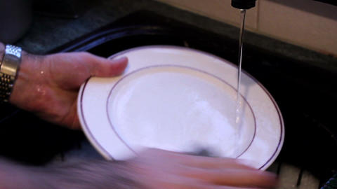 Washing A Plate Under A Running Tap stock footage