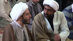 Two clerics in discussion inside shrine in Qom, Ir Footage