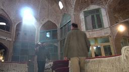 Trader carries carpet through bazaar in Tabriz Ira Footage