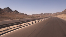 Driving through desert landscape, over highway, Ir Footage